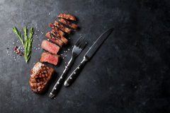 Grilled sliced beef steak. On stone table. Top view with copy space Royalty Free Stock Photos