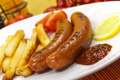 Grilled and sliced fresh pork sausage Royalty Free Stock Photography
