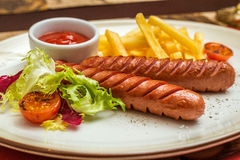 Grilled and sliced fresh pork sausage Stock Photography