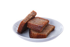 Grilled slices of rye bread. On a white plate Royalty Free Stock Photo