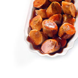 Grilled smoked sausage in BBQ sauce Stock Photography