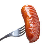 Grilled sausage on a fork Stock Image