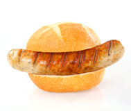 Grilled smoked sausage on a fresh roll Stock Photography