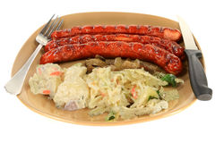 Grilled Smoked Sausages with Garnishes Royalty Free Stock Images