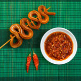 Grilled Snake On Skewer With Chili Sauce And Rice On White Plate On Mat Stock Photography