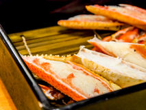 Grilled snow crab legs in Japanese restaurant Royalty Free Stock Photography