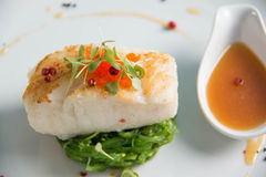 Grilled Snow Fish with  sauce. Stock Photo