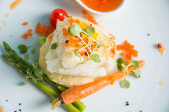 Grilled Snow Fish with  sauce. Royalty Free Stock Photography