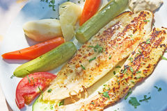 Grilled sole with vegetables. Royalty Free Stock Photo