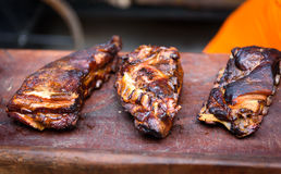 Grilled spare beef or pork back ribs prepared in smoker. Stock Image