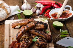 Grilled Spareribs in spicy marinade with beer and rustic bread Royalty Free Stock Photography