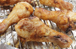 Grilled spiced chicken drumsticks Stock Photography