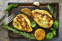Grilled spicy chicken breast with herbs. Stock Photos