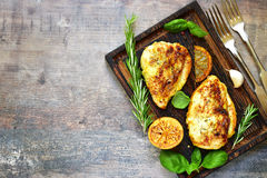 Grilled spicy chicken breast with herbs. Royalty Free Stock Image