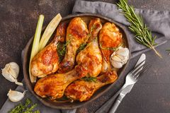 Grilled spicy chicken legs baked with garlic, rosemary and thyme royalty free stock image