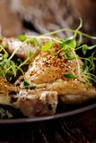 Grilled spicy chicken legs with herbs Royalty Free Stock Image