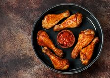 Grilled Spicy chicken legs with tomato sauce stock photo
