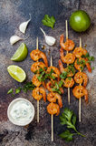 Grilled spicy lime shrimp skewers with creamy avocado garlic cilantro sauce. Top view, overhead, flat lay. Stock Photography