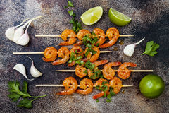 Grilled spicy lime shrimp skewers with creamy avocado garlic cilantro sauce. Top view, overhead, flat lay. Royalty Free Stock Photography
