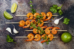 Grilled spicy lime shrimp skewers with creamy avocado garlic cilantro sauce. Top view, overhead, flat lay. Stock Image