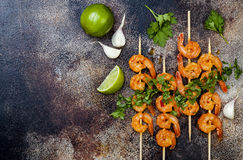 Grilled spicy lime shrimp skewers with creamy avocado garlic cilantro sauce. Top view, overhead, flat lay, copy space. Royalty Free Stock Image