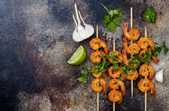 Grilled spicy lime shrimp skewers with creamy avocado garlic cilantro sauce. Top view, overhead, flat lay, copy space. Royalty Free Stock Photography