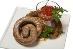 Grilled spicy sausage with sauerkraut Royalty Free Stock Photos