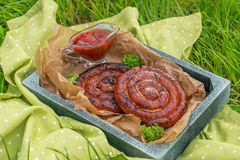 Grilled spiral sausages Royalty Free Stock Images