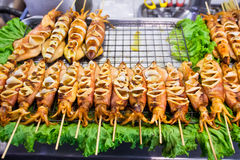 Grilled squid. On the street in Bangkok Royalty Free Stock Photos