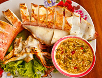 Grilled squid. In meal time Thailand Stock Photos