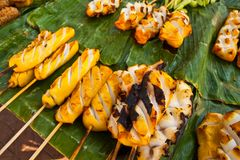 Grilled Squid on banana leaves Stock Photo