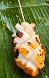 Grilled Squid on banana leaves. Ready for eat Stock Image