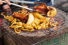 Grilled squid. On the grill Stock Photos