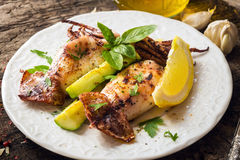 Grilled squid with lemon and zucchini Stock Images