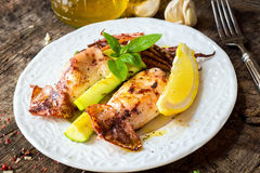 Grilled squid with lemon and zucchini Royalty Free Stock Images