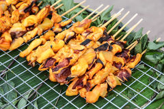 Grilled squid and octopus stick Stock Photos