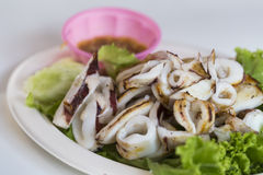 Grilled squid with seafood sauce Royalty Free Stock Photo