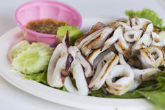 Grilled squid with seafood sauce Stock Images