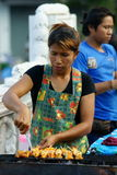 Grilled Squid Vendor at Wat Saket compound. Stock Photography