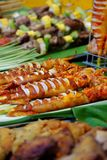 Grilled squid, Vietnamese street food. Asian food at cuisine fair, grilled seafood from squid that marinated in spice, chili ready to grill, close up of Thai Stock Image
