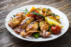 Grilled squids with asparagus and potatoes Stock Image