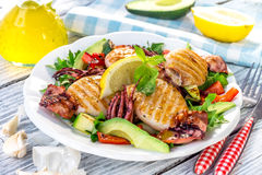 Grilled squids with vegetable Stock Image