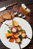 Grilled squids with vegetables Stock Images