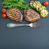 Grilled steak with arugula Stock Images