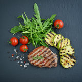 Grilled steak with arugula Royalty Free Stock Images