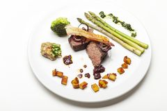 Grilled steak. With asparagus on a plate stock images