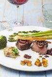 Grilled steak. With asparagus on a plate stock photography