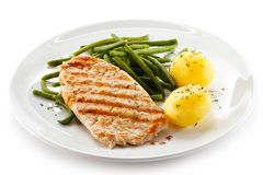 Grilled steak, boiled potatoes and green bean royalty free stock images