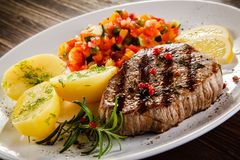 Grilled steak, boiled potatoes and vegetable salad stock photo