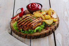 Grilled steak on the bone. With potatoes stock photography